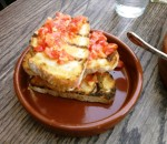 Pan Con Tomate, grilled sourdough rubbed with fresh tomato, garlic, extra virgin olive oil