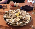Two dozen oysters on the half shell