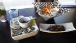 Yam fries with gojujang aioli, honey garlic fried anchovies and east coast oysters with kimchi mignonette, tabasco and lime