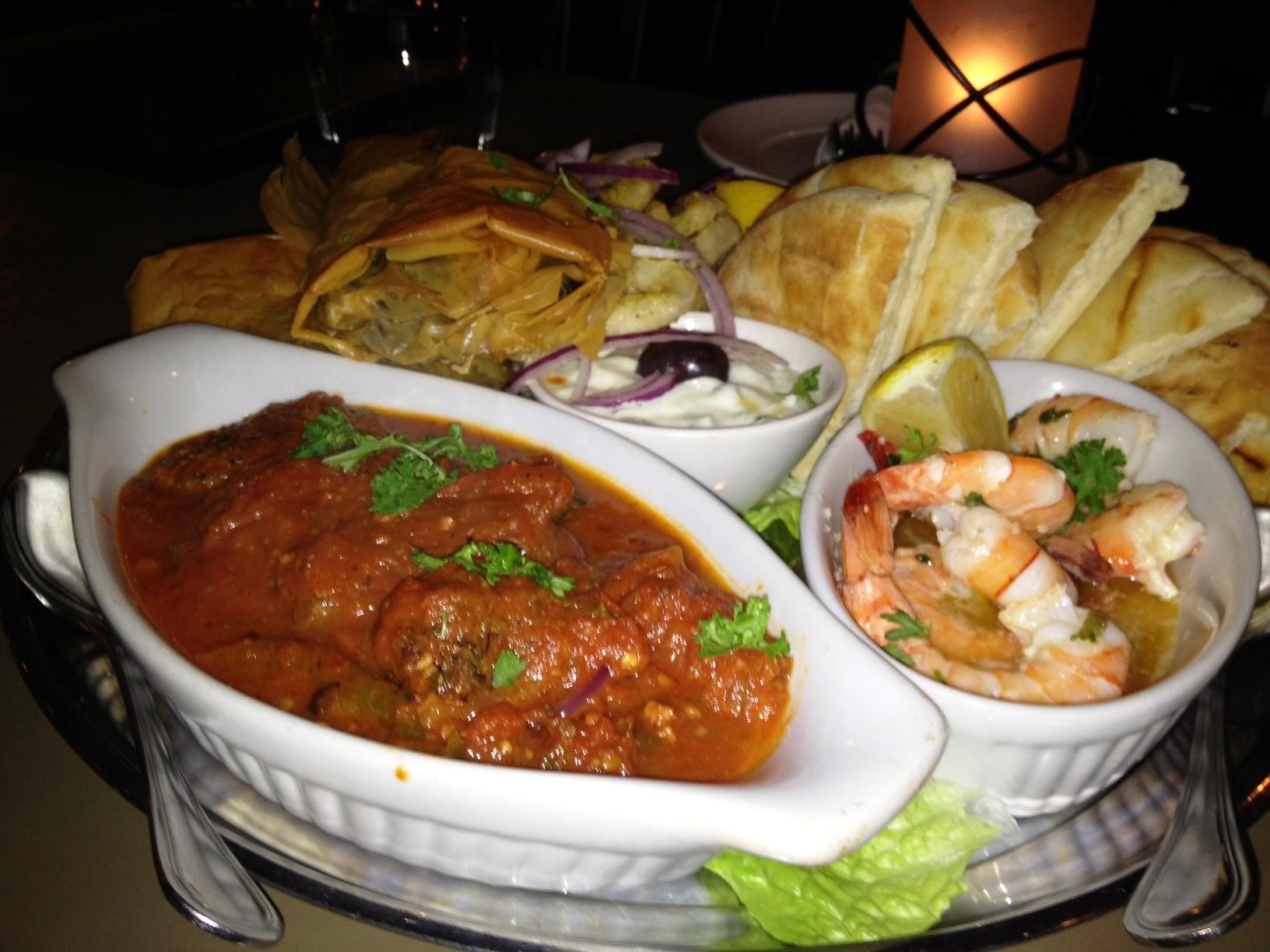 Appetizer Platter for TwoCalamari, poseidon garithes, spanakopita, soutzoukakia, tzatziki and pita