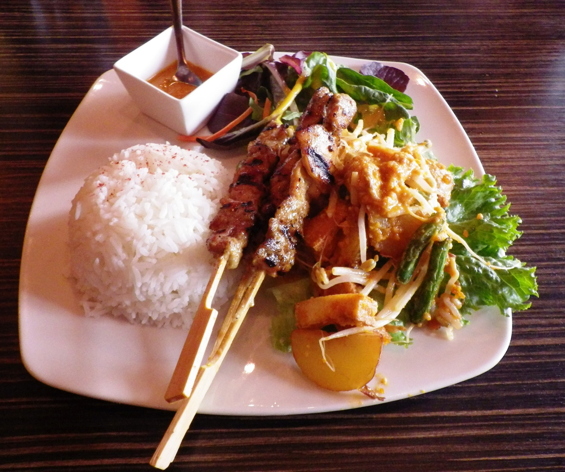 Satay Chicken, Gado Gado with Rice Famous Malaysian skewers served with a bean sprout tofu salad topped with peanut dressing.