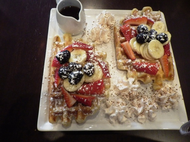 Liege Breakfast Two Liege Waffles served with freshly whipped cream, mixed berries and all-natural Canadian syrup