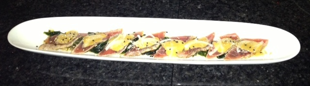 Seared sashimi grade ahi-tuna served on top of a variety mix of seaweed with a touch of kani-su and house miso dressing