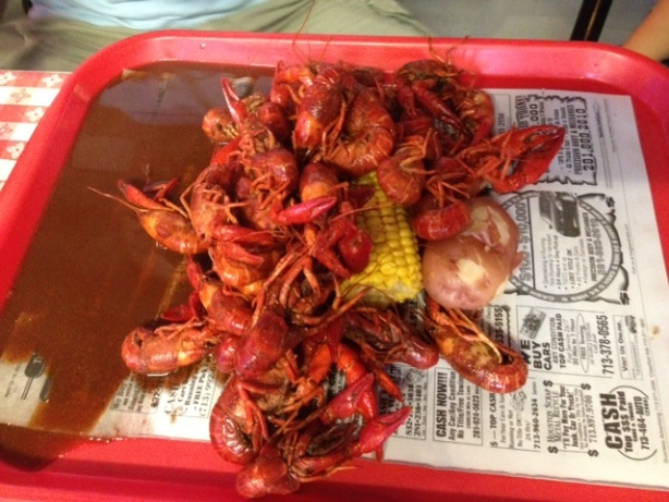 Boiled crawfish served with corn and potato