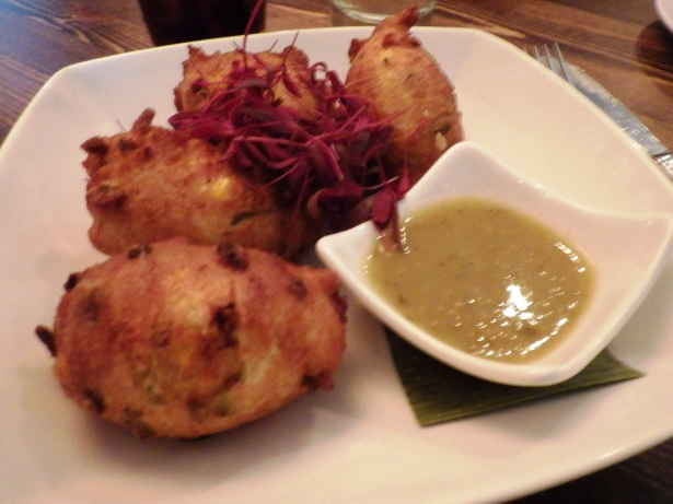 Corn and roasted jalapeno fritters with tomatillo buckwheat honey dip