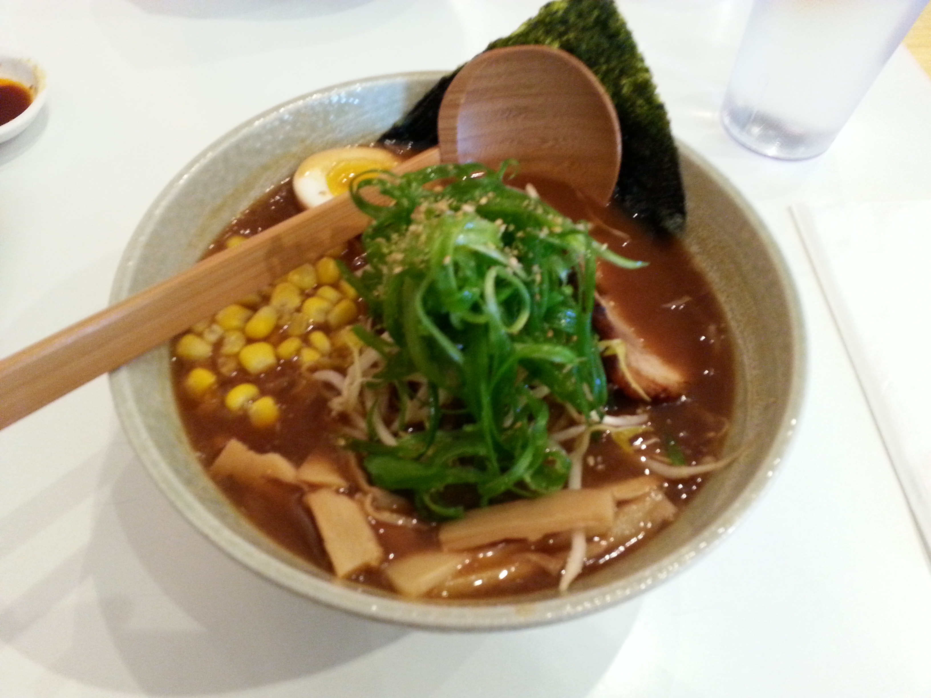 Curry ramen with bean sprouts, soft boiled egg, cha shu, Kan-pyo, nori and corn