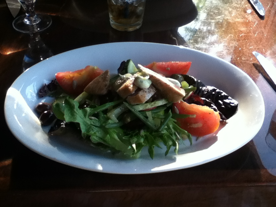 SEARED AHI TUNA radish, heirloom tomato, capers, cucumber, olives, haricot vert, sunflower