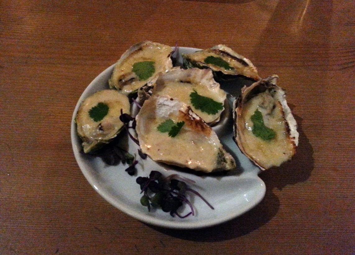 Feature warm oysters with parmesan cheese and alfredo sauce
