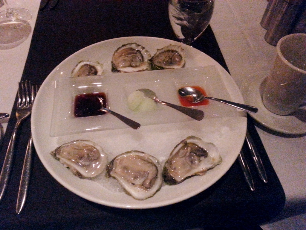 Oysters with Juniper spicy kick, gin ice and citric pomegranate