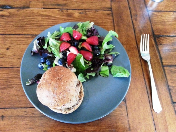 Slider with strawberries, blueberries and spring greens with chili balsamic dressing