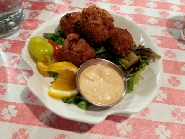 Boudin Balls Blend of beef, pork, onion, rice, peppers and seasonings served with Creole mustard