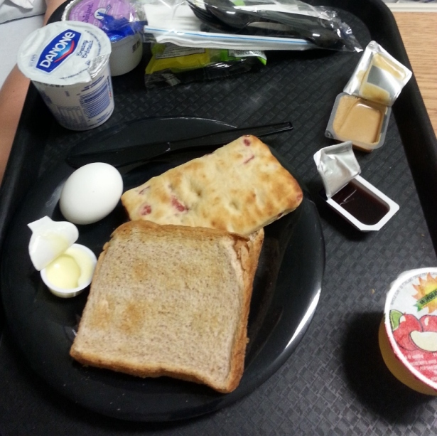 Breakfast - Orange cranberry pop tart, toast with peanut butter and jam, hard boiled egg, apple slices, milk and apple juice