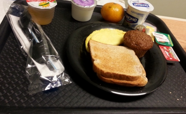 Breakfast Scrambled egg, toast, bran muffin, mandarin orange, milk and apple juice