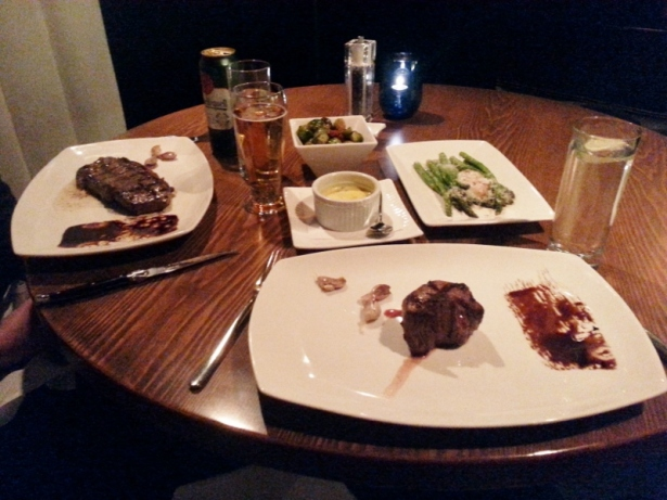 L-R 10 oz Wagyu New York Strip, brussels sprouts and bacon, Bearnaise sauce, asparagus parmesan with 63 degree egg and 7 oz filet